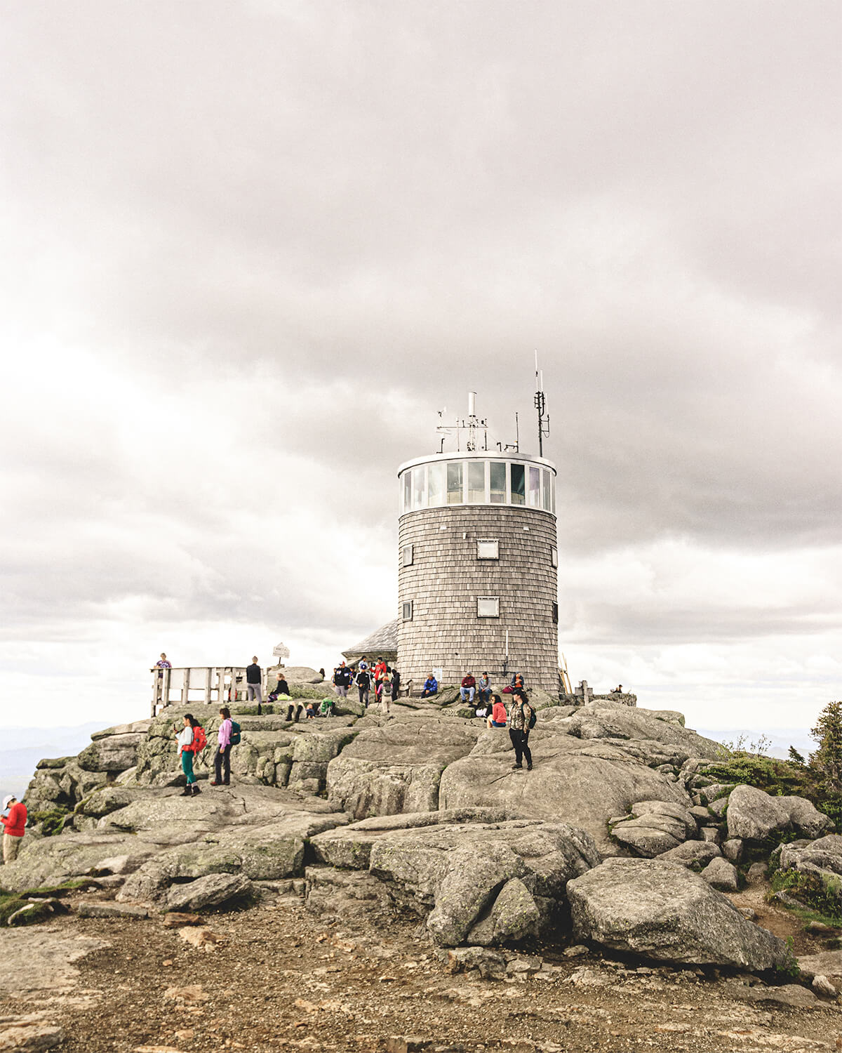 Hikers taking in the views around the lighthouse of Whiteface Mountain