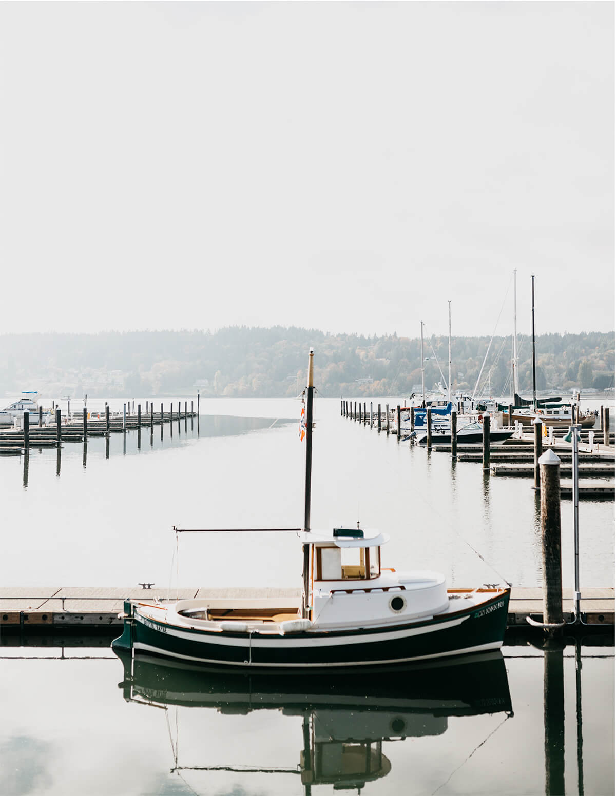 A small boat docked off the coast of Poulsbo, Washington