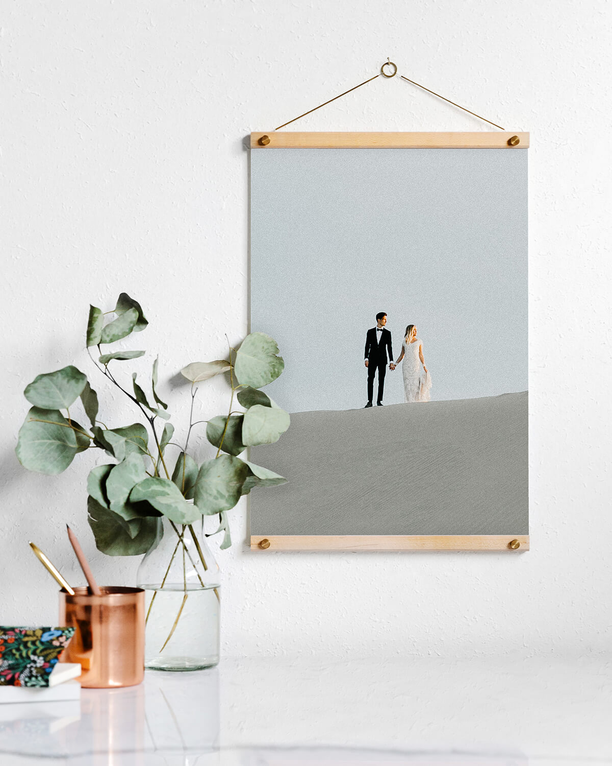 Wooden photo hanger holding print