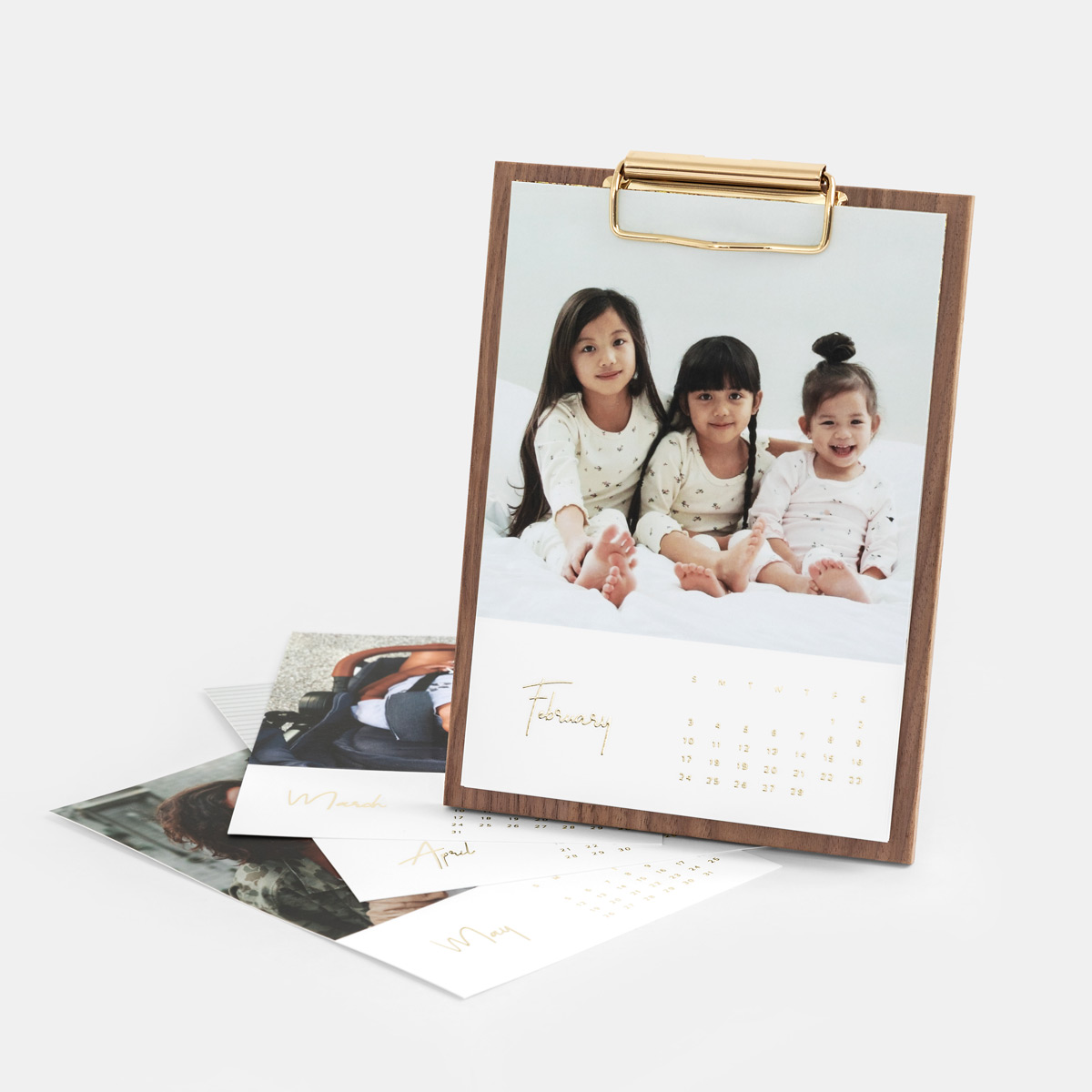walnut desk calendar with photo of children