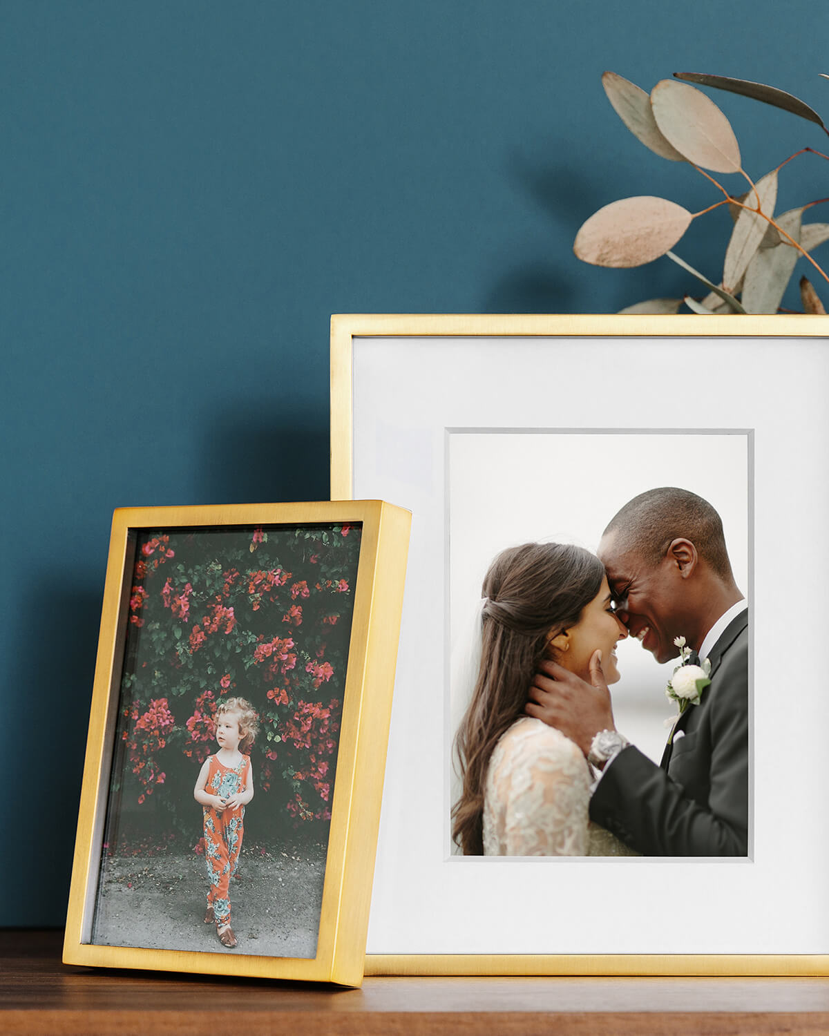 metal frames standing on mantel with photo of couple and child
