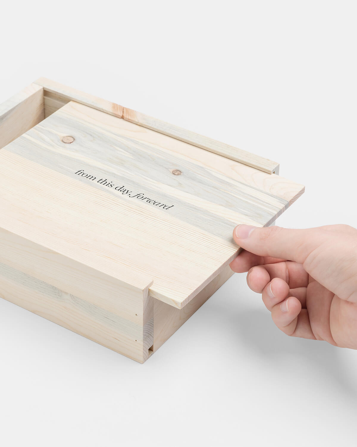 wooden quote box being opened by hand