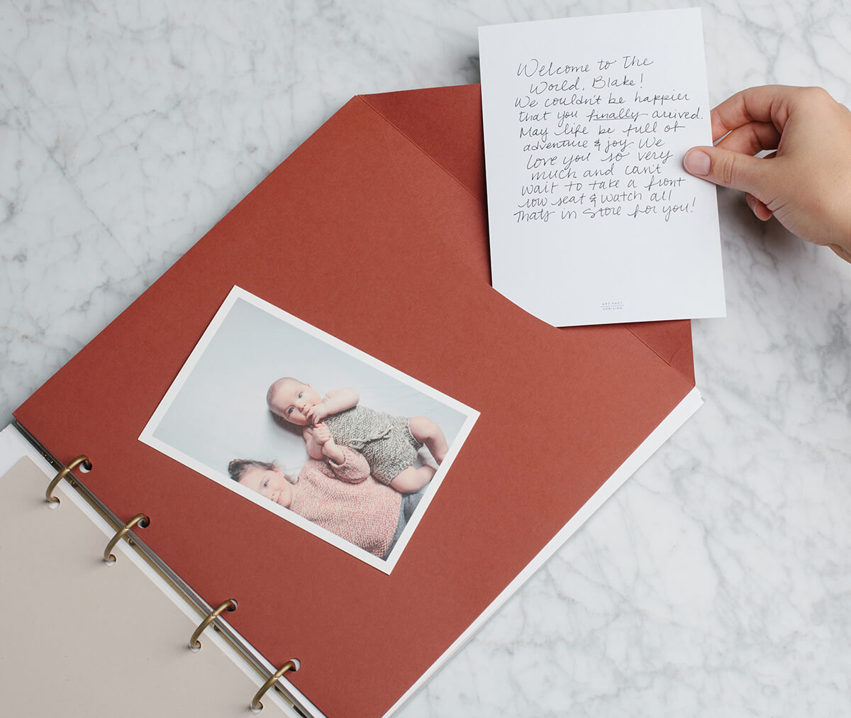 Artifact Uprising Story of You Baby Book being used as a guest book for baby's first birthday