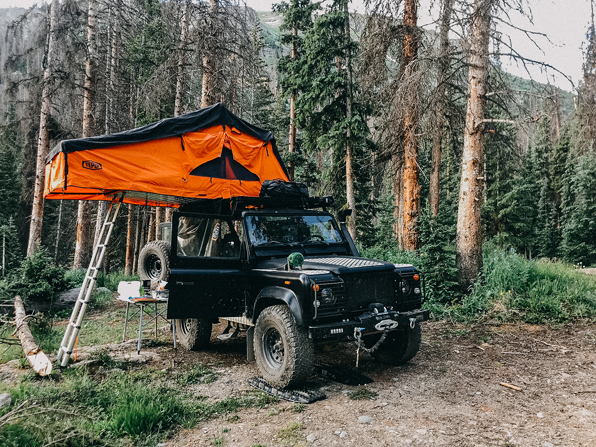 Jeep in mountain with car roof tent