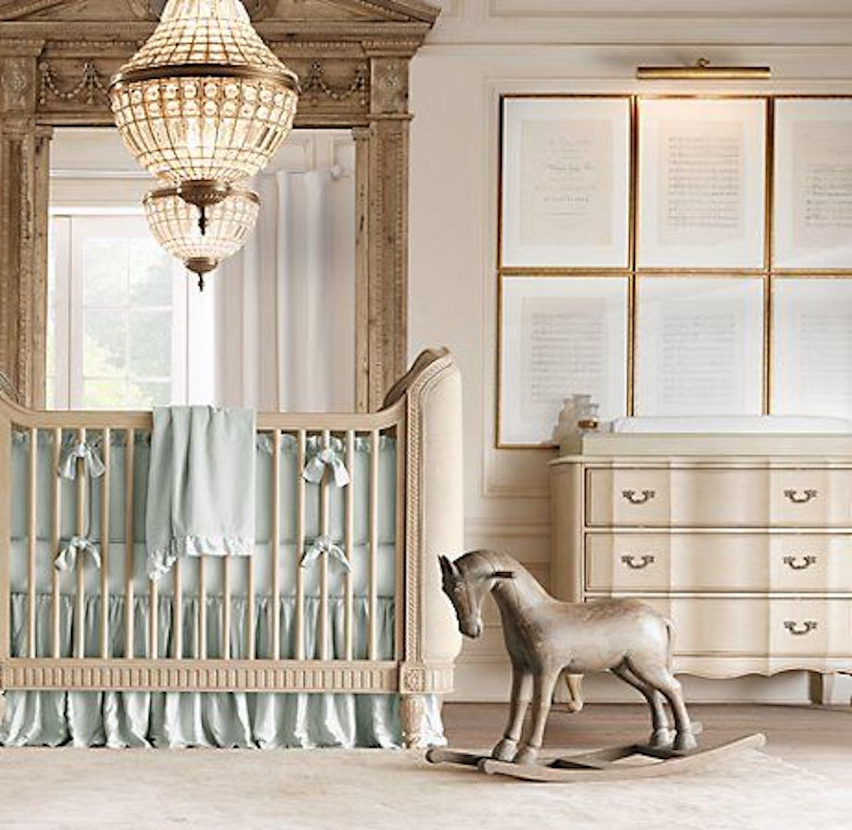 Gallery wall, crib, and rocking horse in nursery room