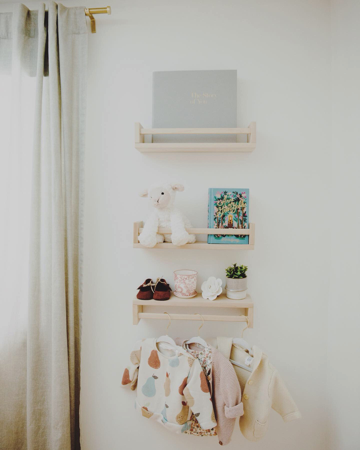 Wall storage in baby girl nursery room
