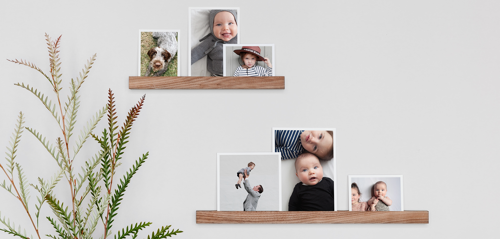 Photo prints on wooden ledges are one of many nursery wall decor ideas