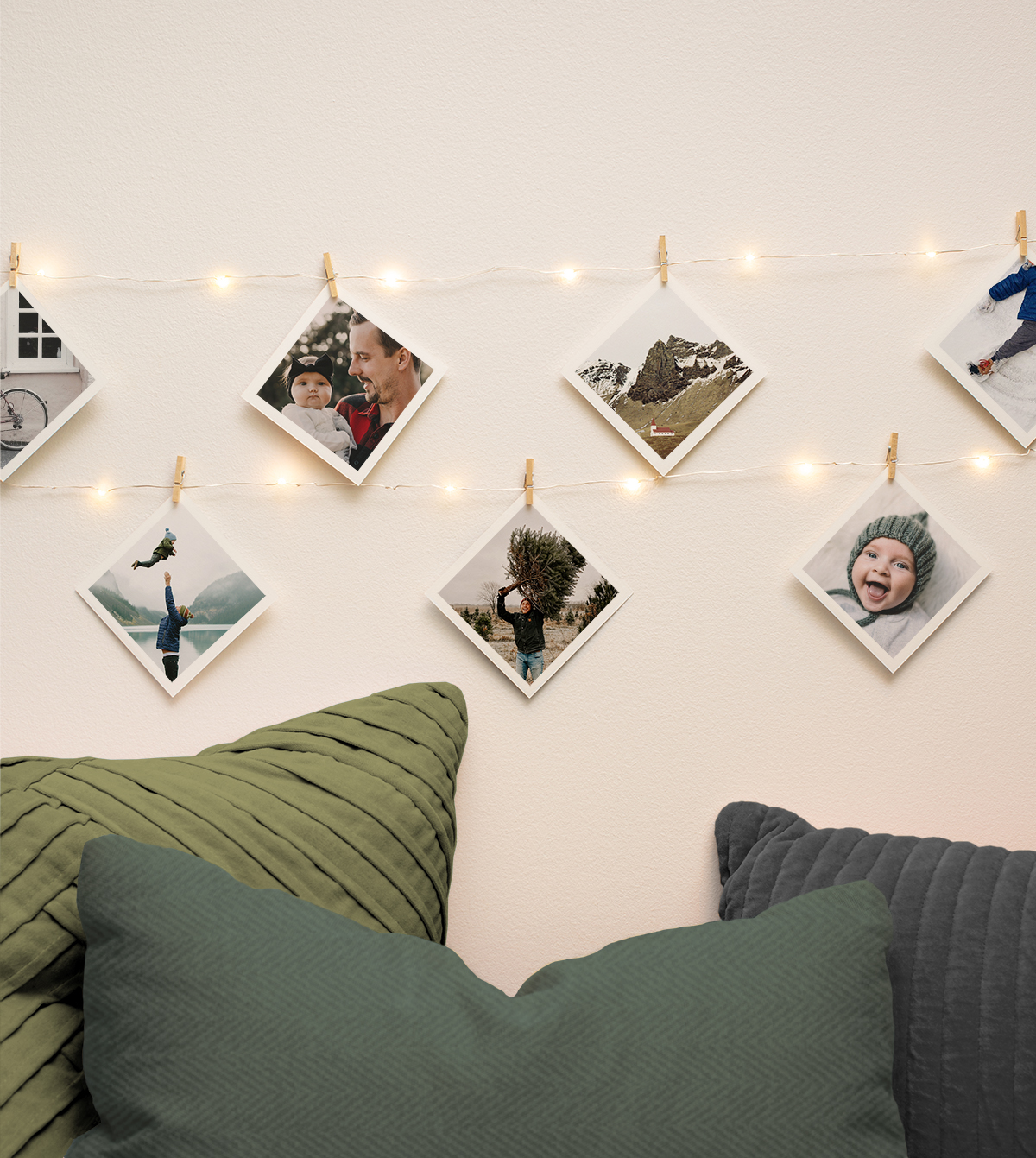 Family photos strung up on the wall using holiday lights