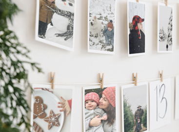 A holiday advent calendar created with prints hung from a line