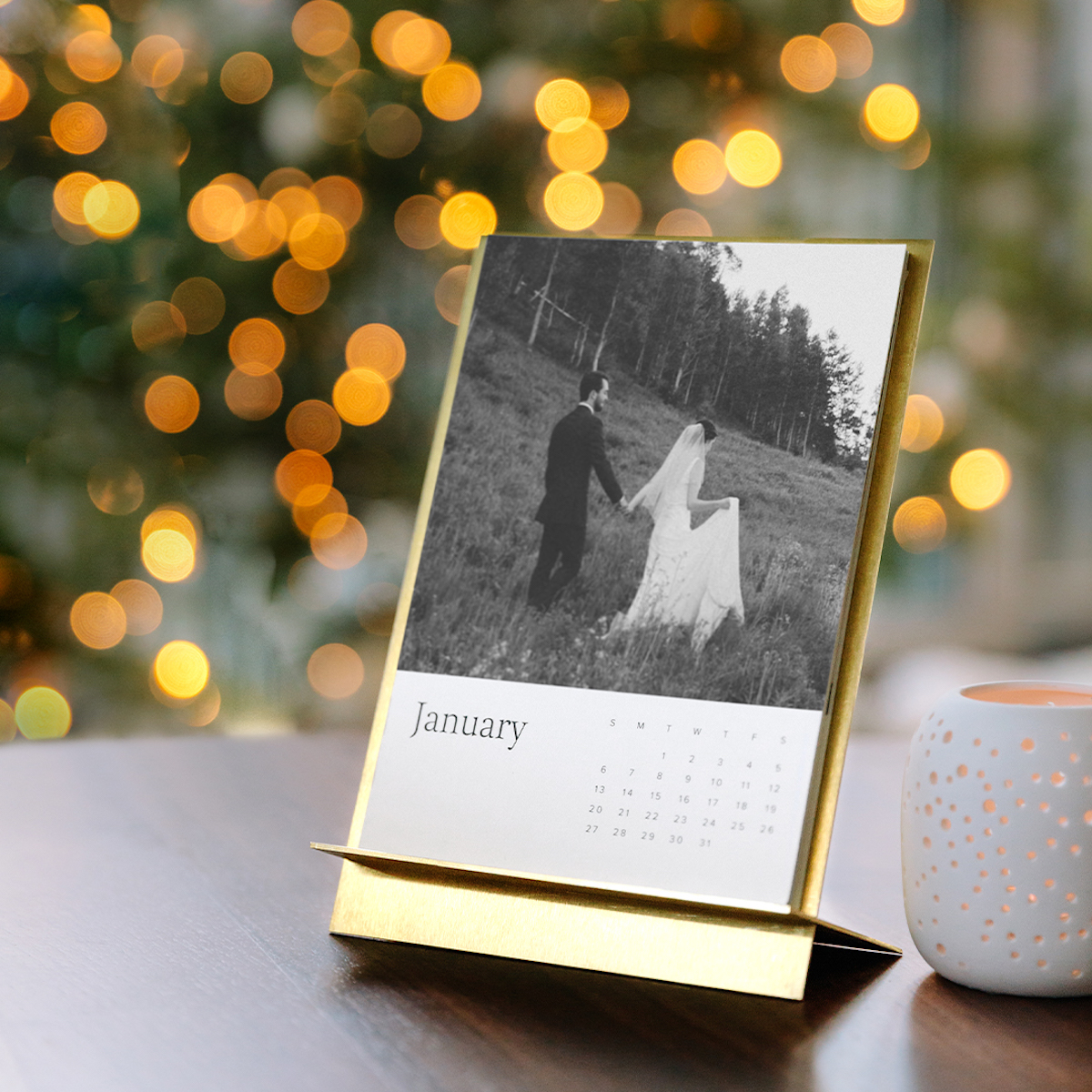 Brass Easel Calendar with photo of married couple in front of tree with string lights