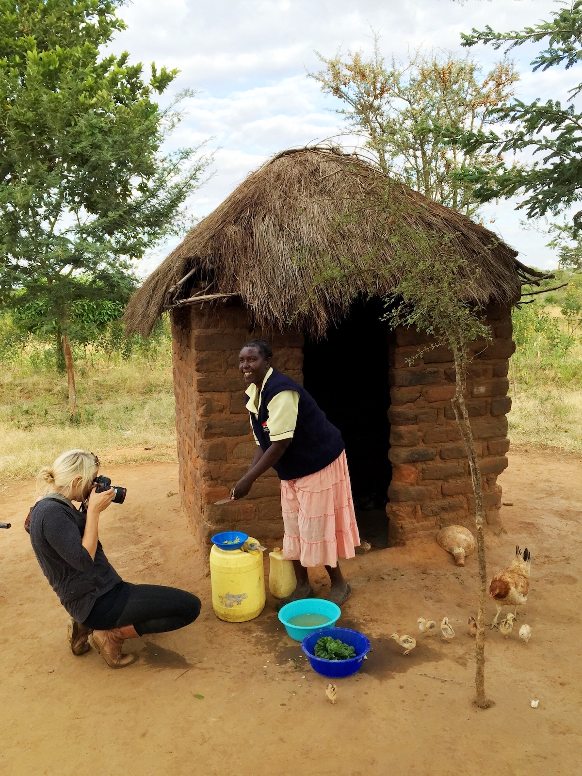 Esther Havens photographing a Kenyan farmer