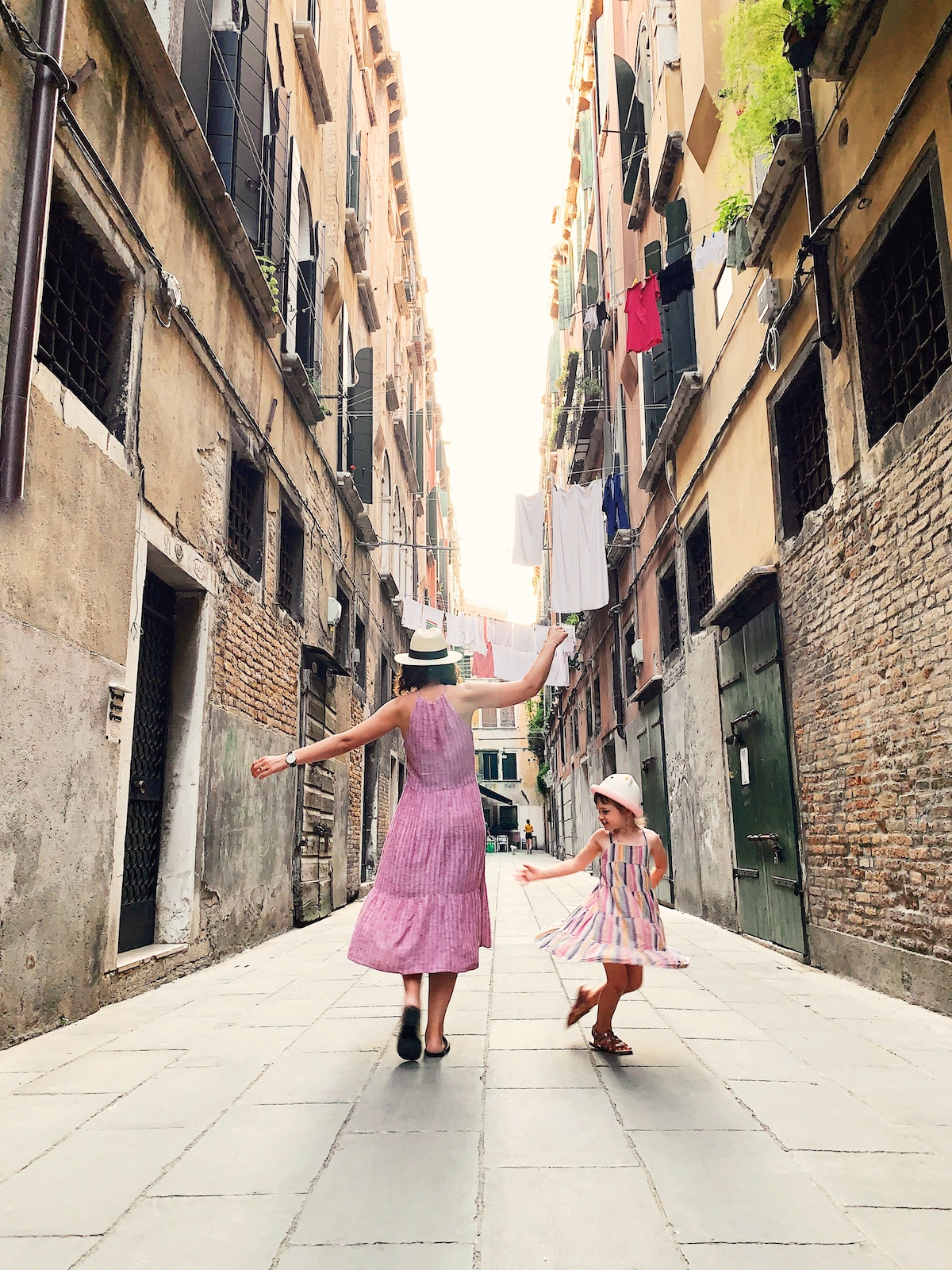 A mother and daughter dance in the streets of Italy