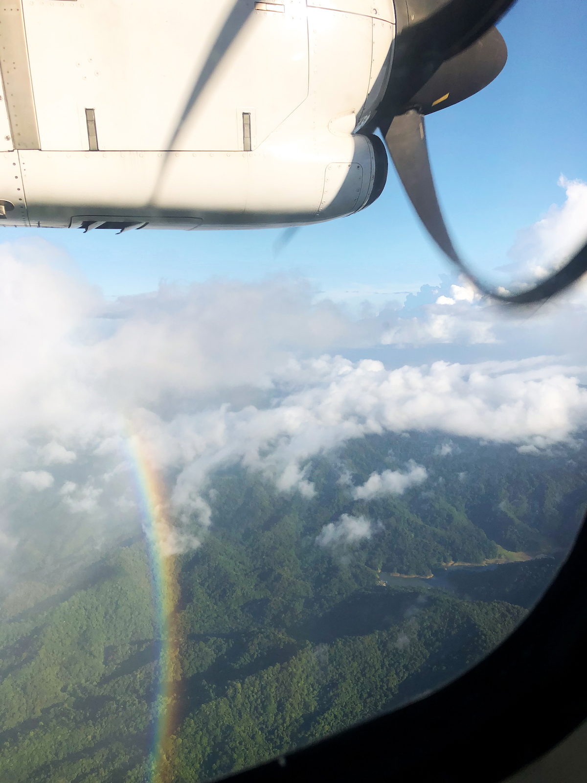 Photo of rainbow taken from airplane window