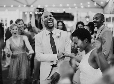 married couple on dance floor with friends