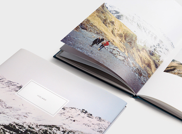 Travel photo book open to middle spread
