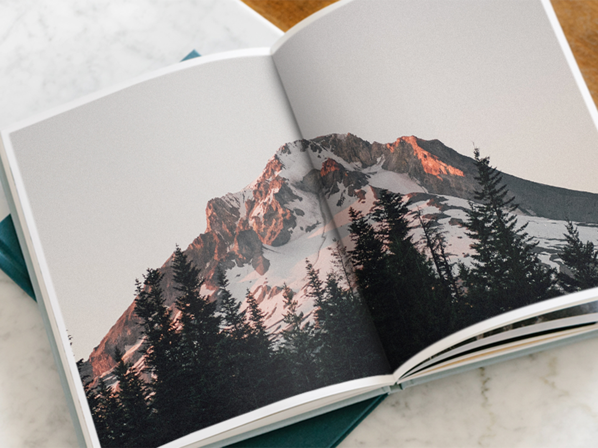 Hardcover Photo Book opened to picture of mountainscape