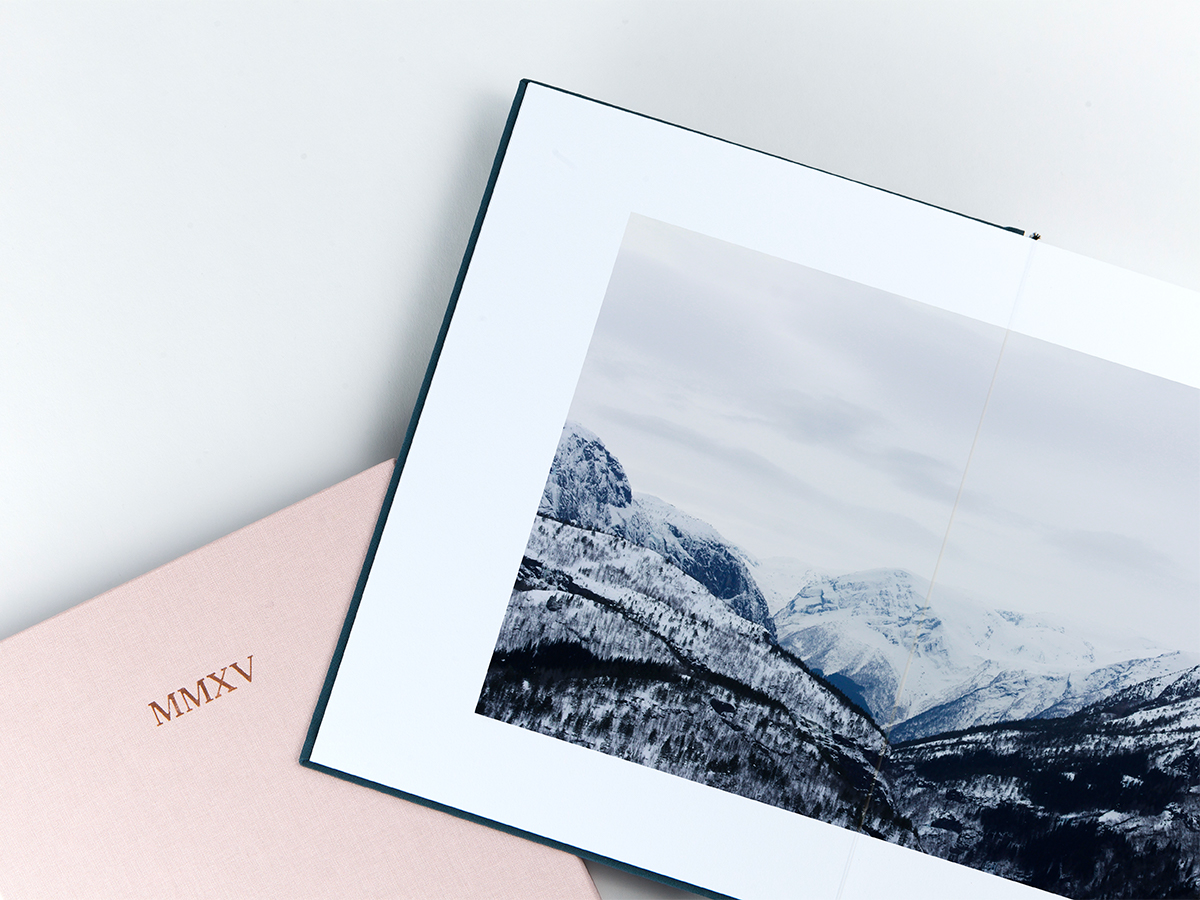 Layflat Photo Book opened to two page image of snowy mountains