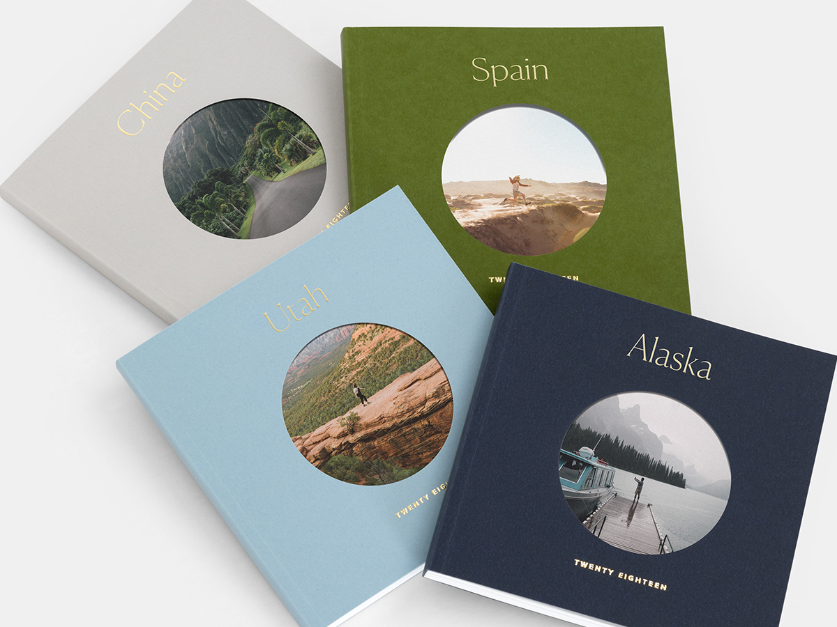 Four Color Series Photo Books with titles representing different travel destinations