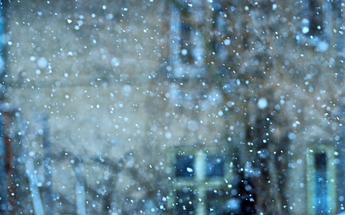 Blurred photograph of snow falling in the city