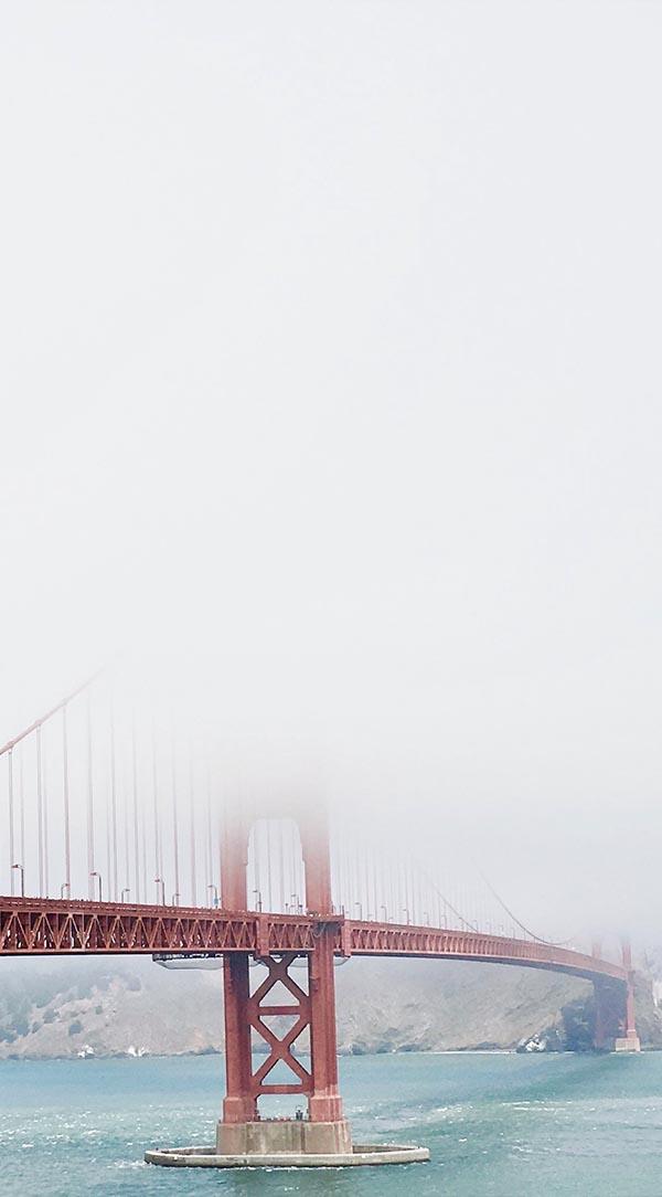 Cropped photo of Golden Gate Bridge shrouded in misty fog