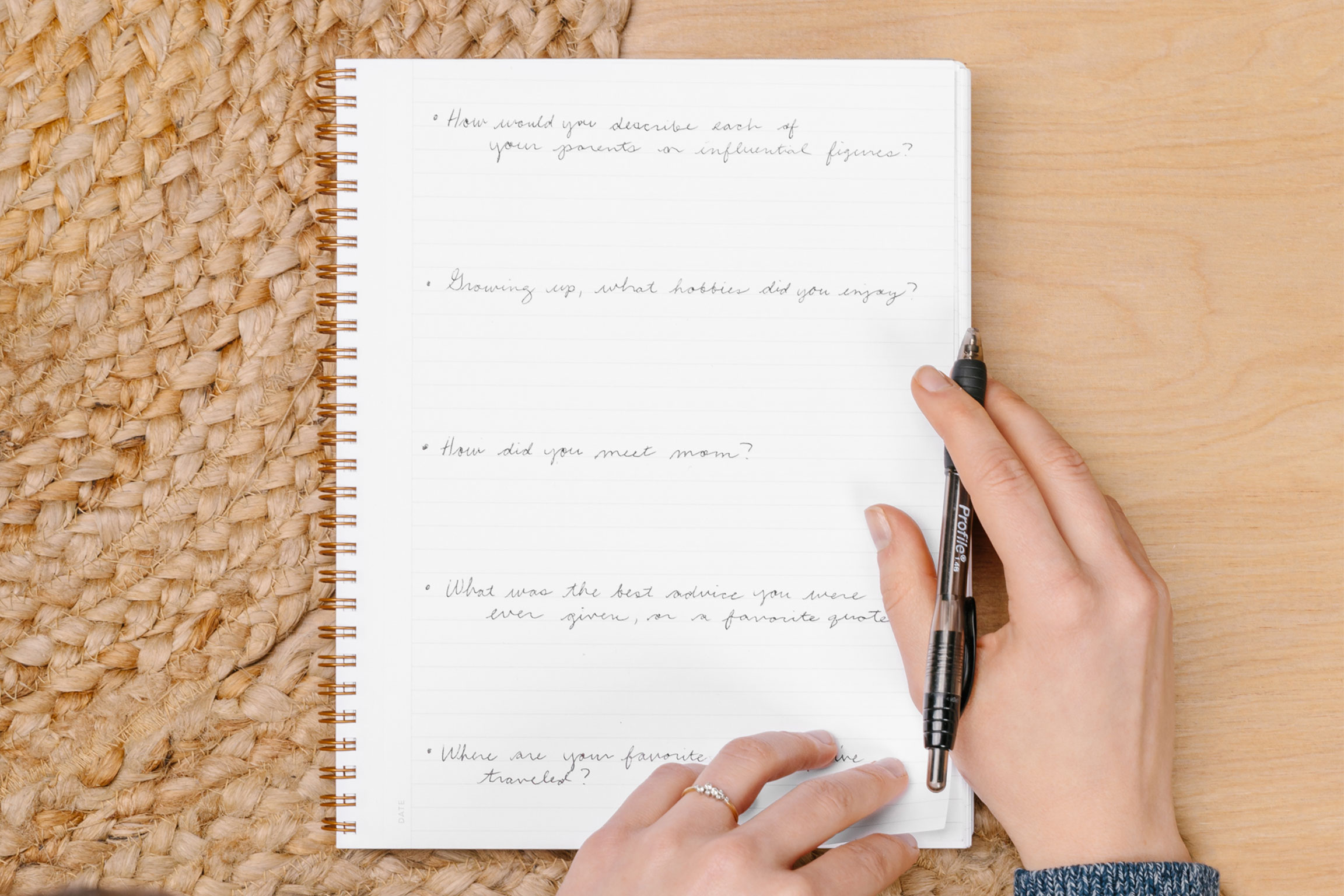 Woman writing family history questions
