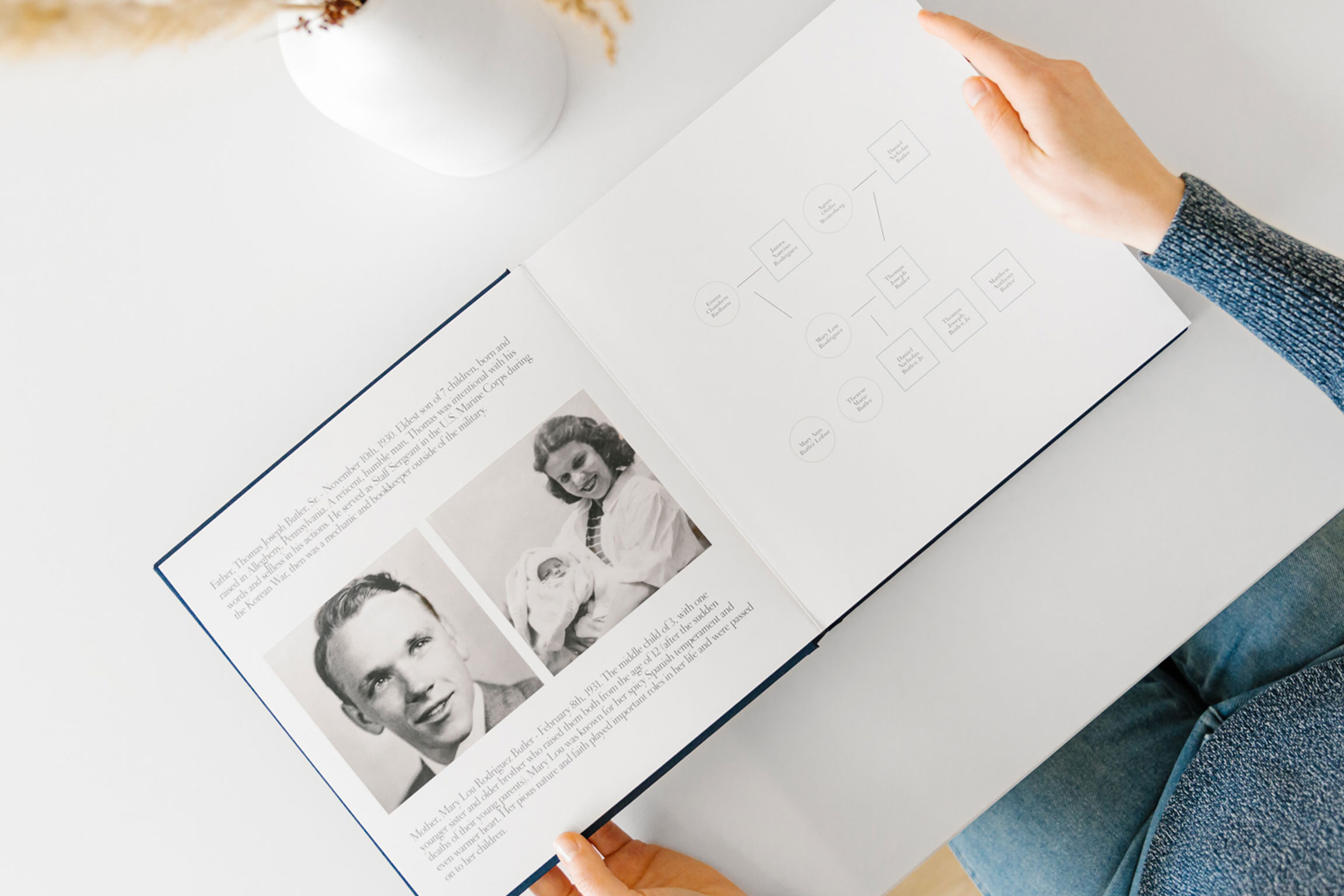 Family history book with old photos and family tree