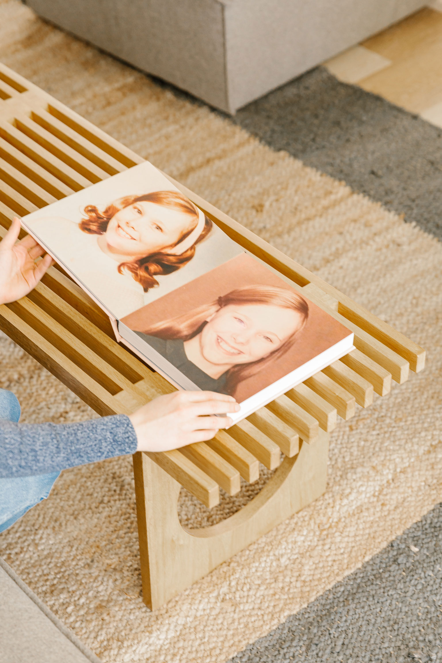 woman flipping through family history book later pages