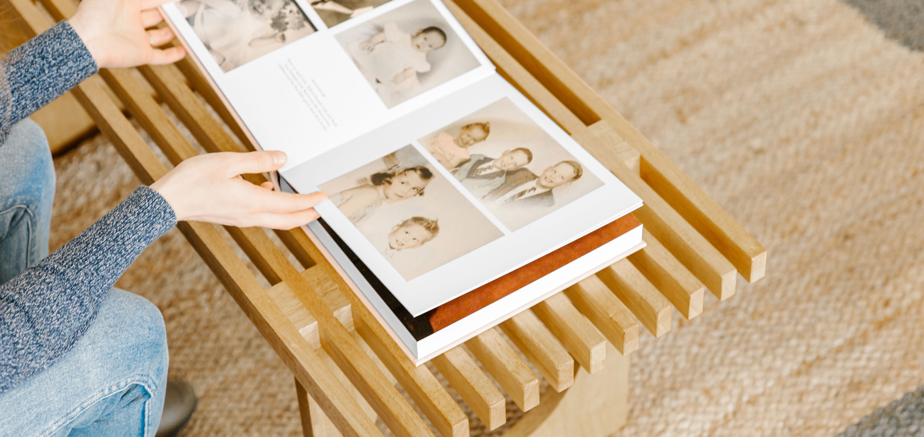 woman looking through family history book
