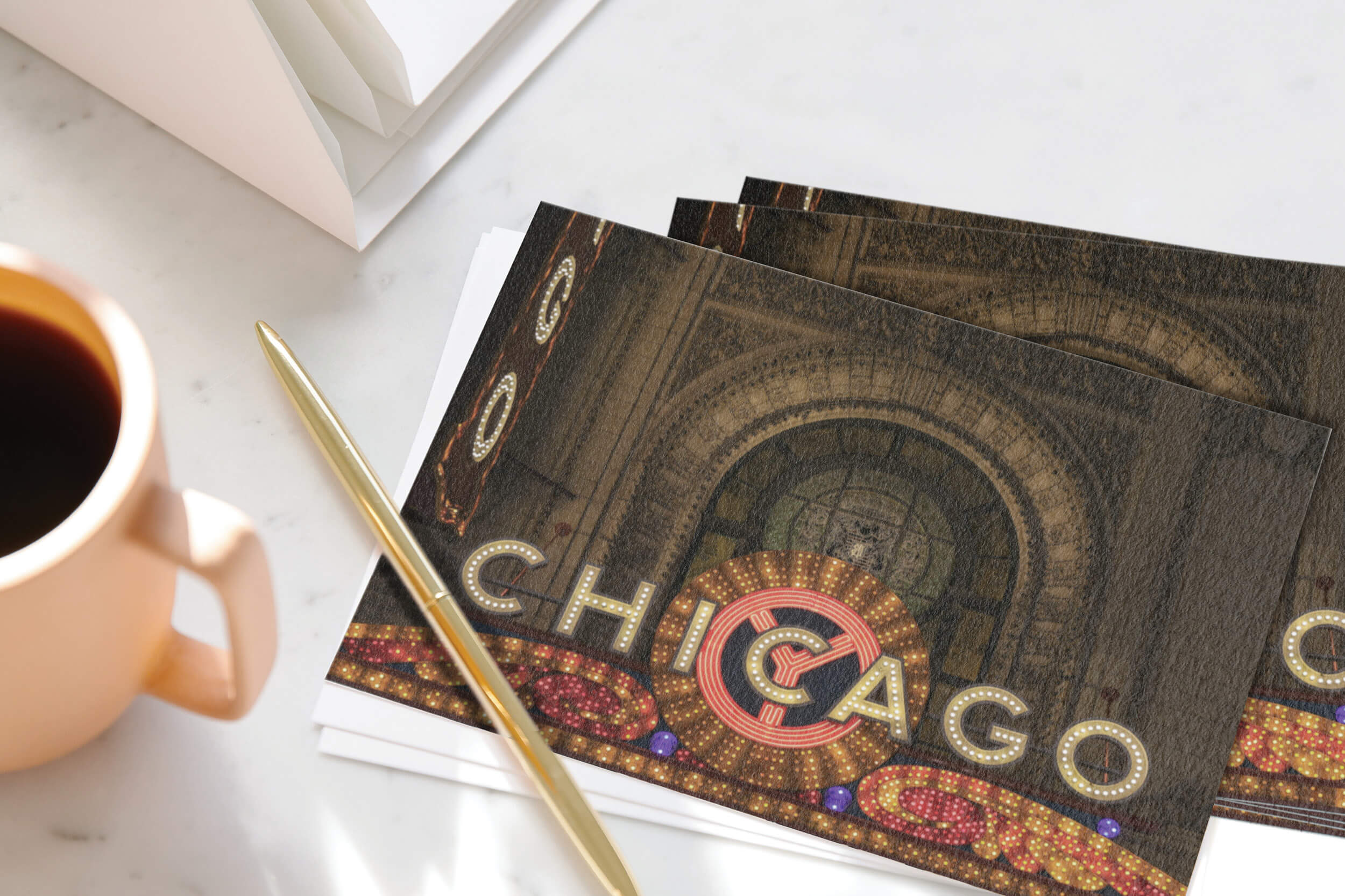 Pen resting on stack of Chicago postcards