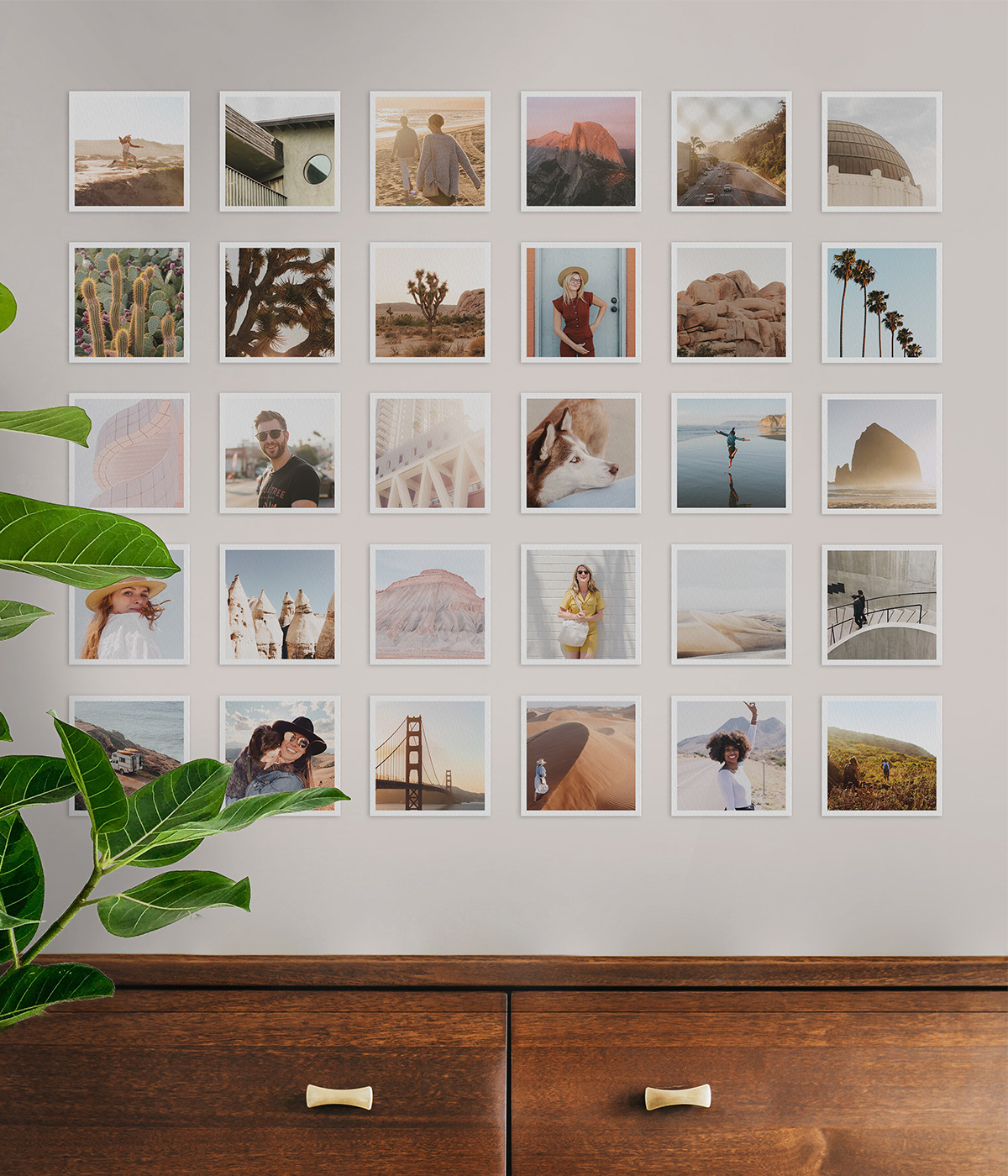 Grid of square photo prints on wall of home