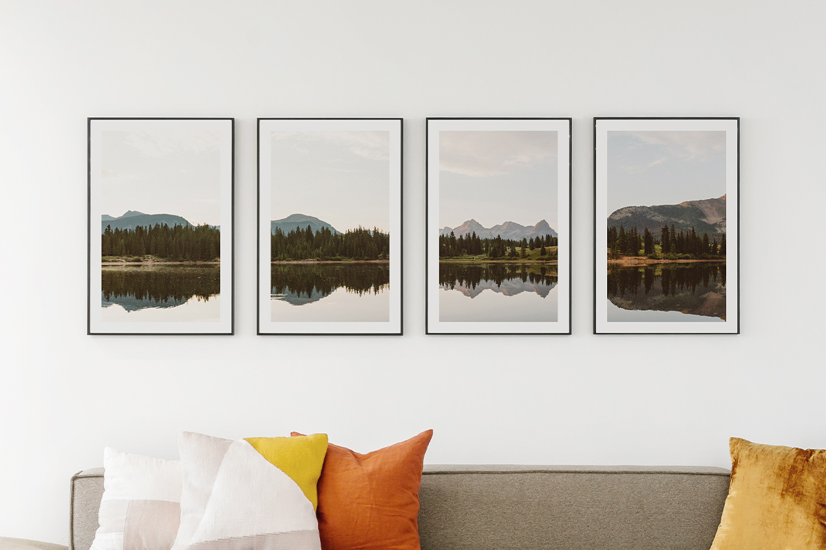 Panoramic photo of mountain landscape split evenly between four frames on the wall