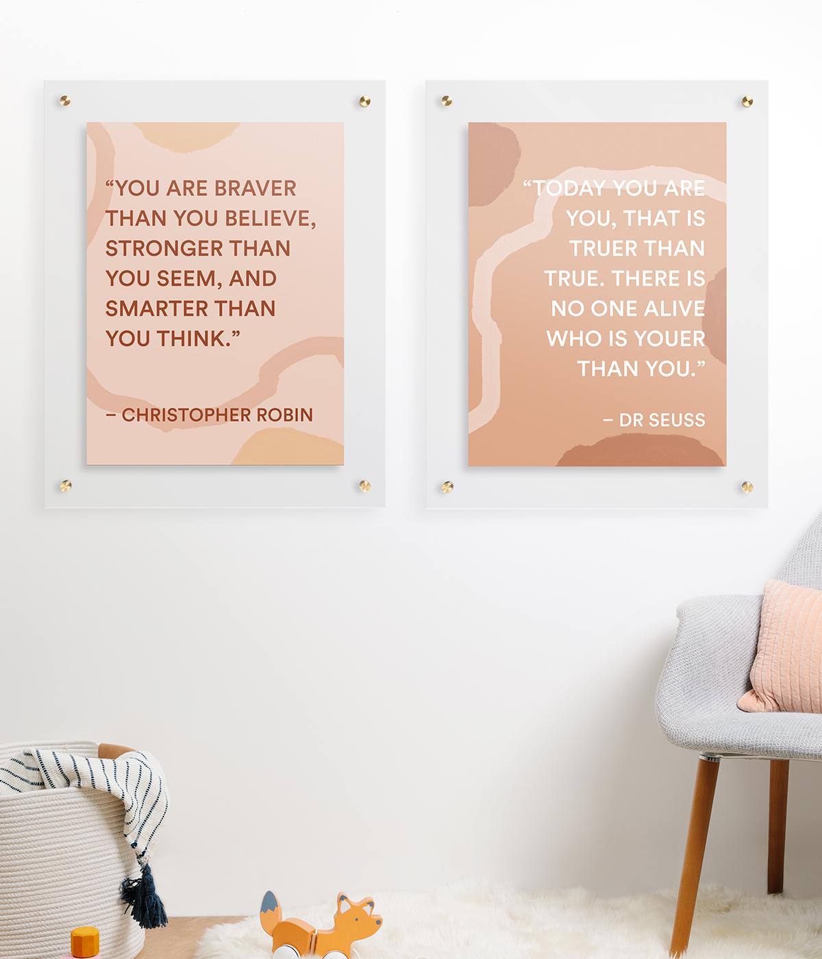 Two identical frames in nursery room with quotes from Dr. Seuss and Christopher Robin