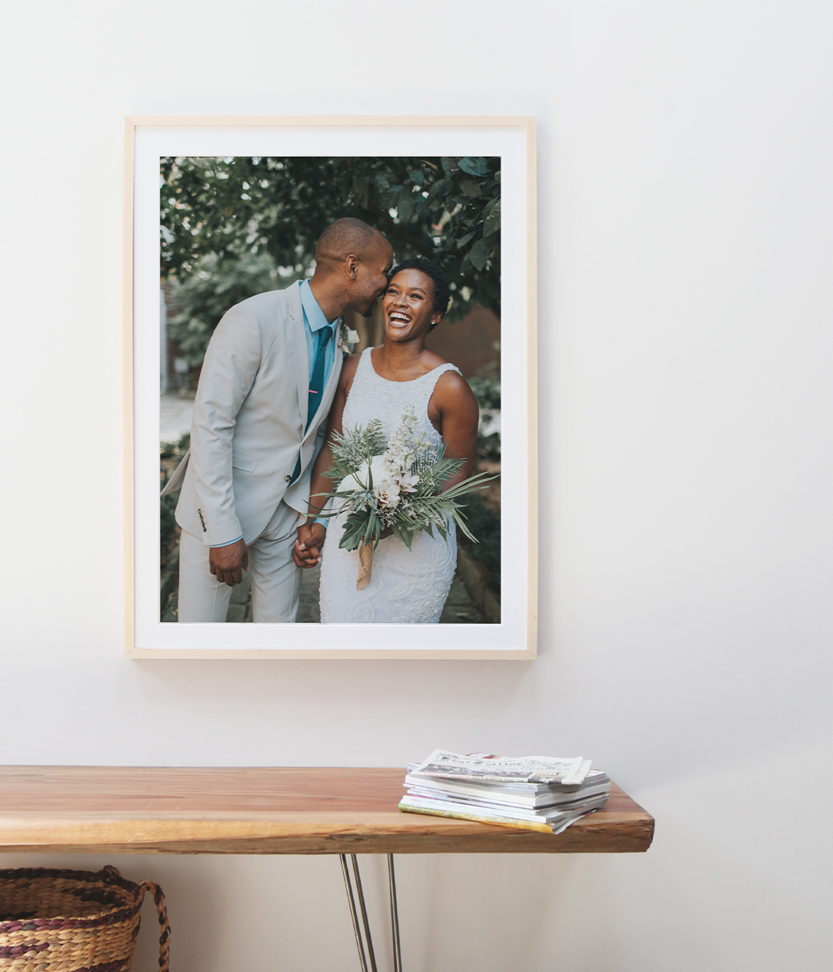 Large framed wedding print of young couple above wood bench