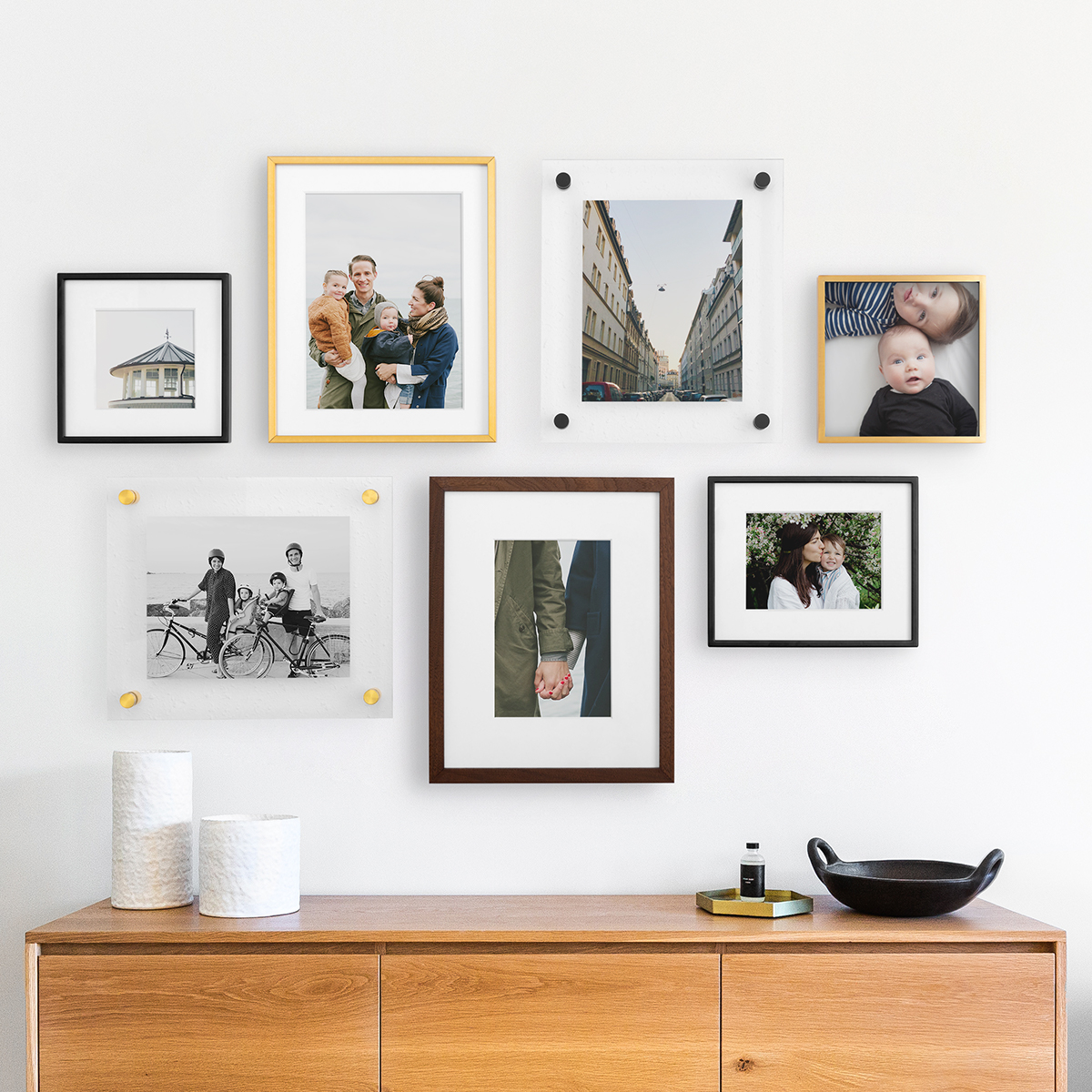 Gallery wall that mixes and matches sizes, styles, and finishes