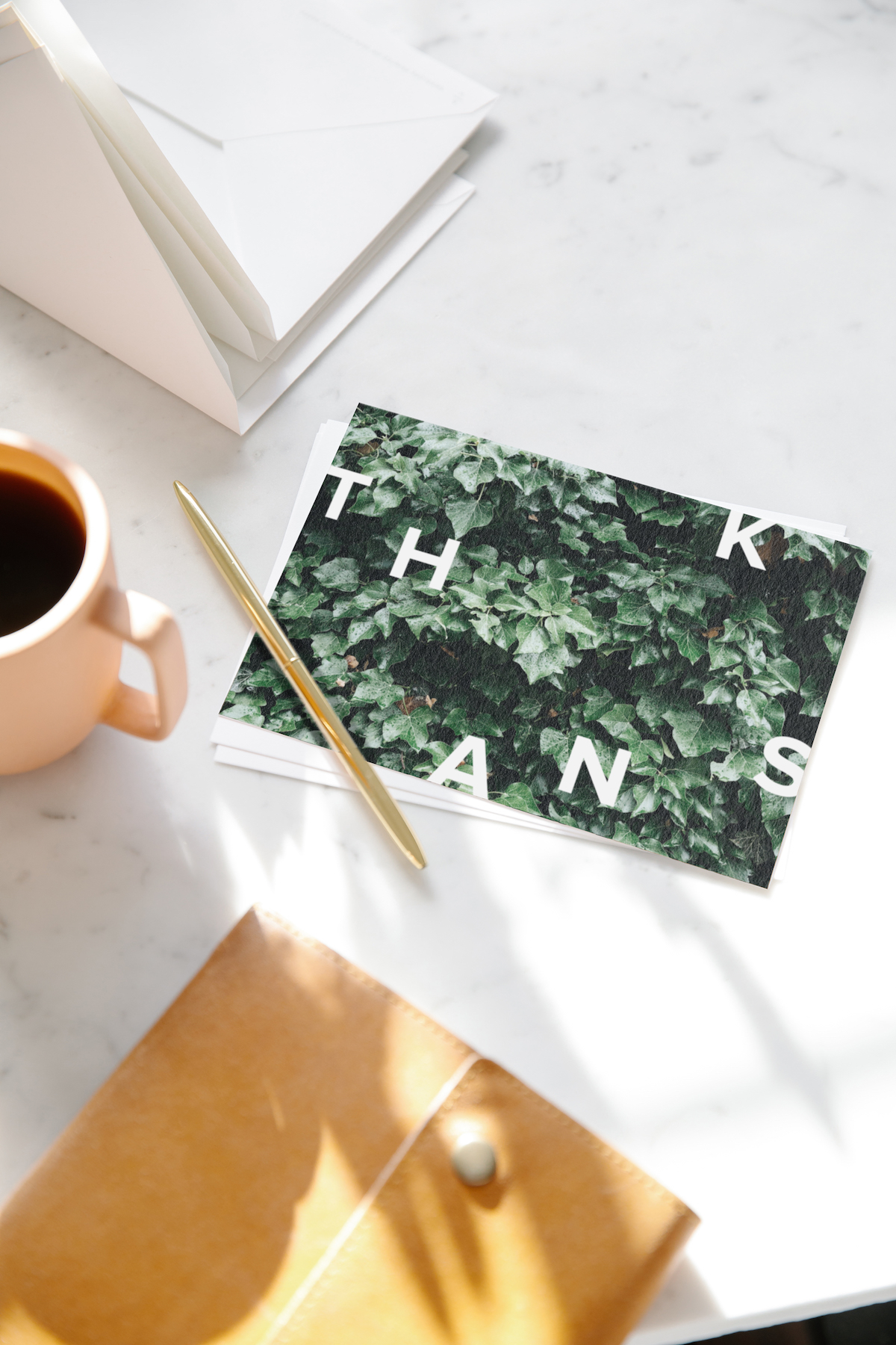 Thank you card sitting next to cup of coffee