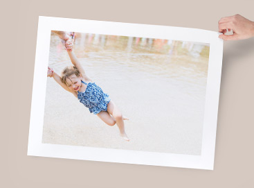 Enlarged print of little girl playing in the water
