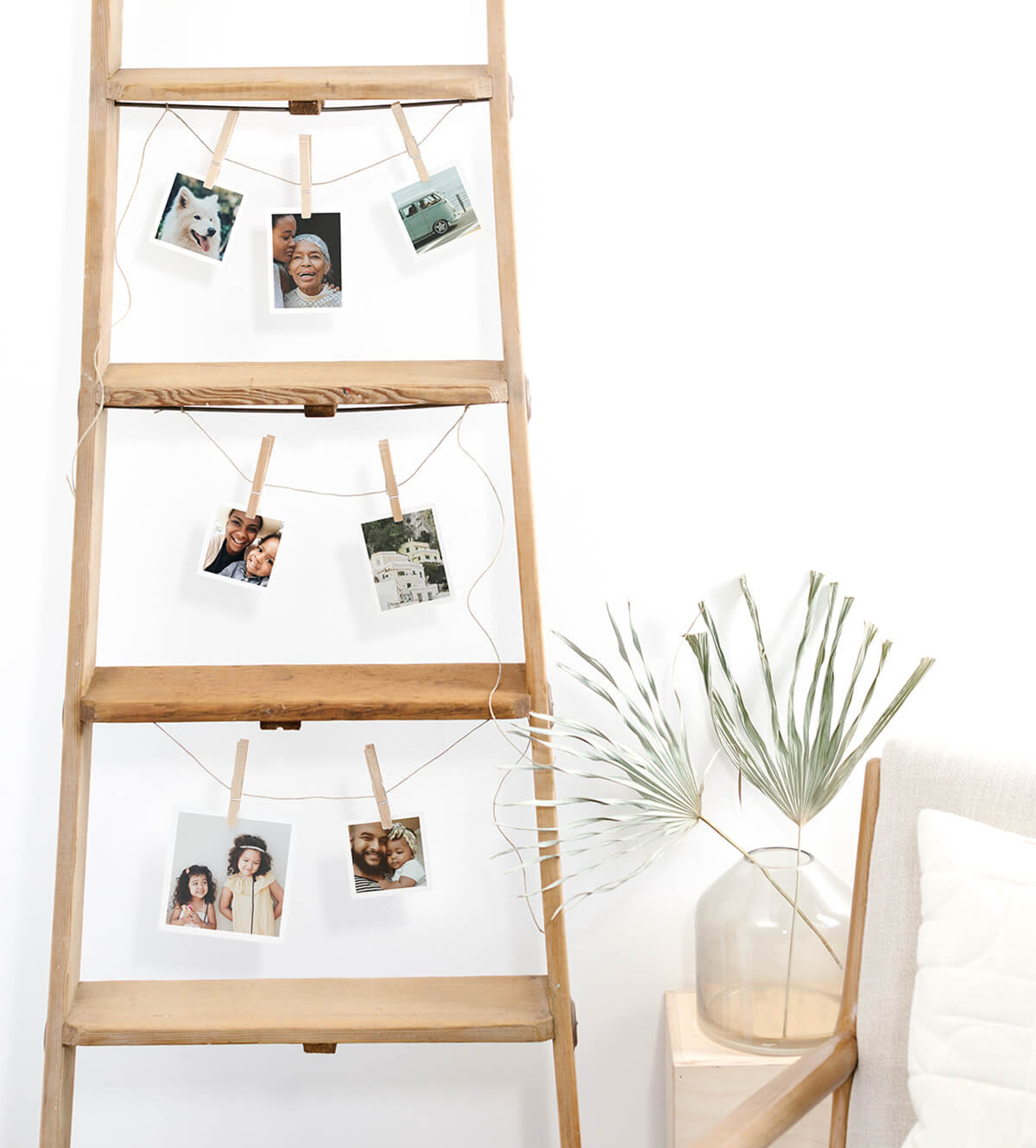 Wooden ladder repurposed to display photo prints