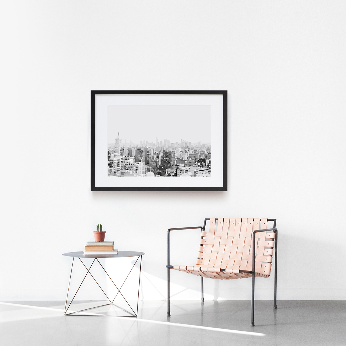 Minimalist interior design scene with chair, sidetable, and frame
