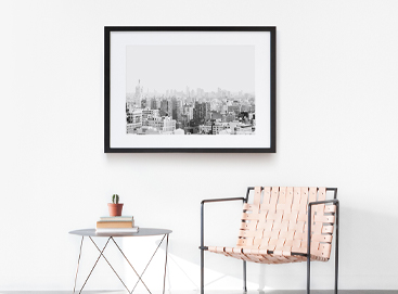 Chair, side table, and framed photo in minimalist room design