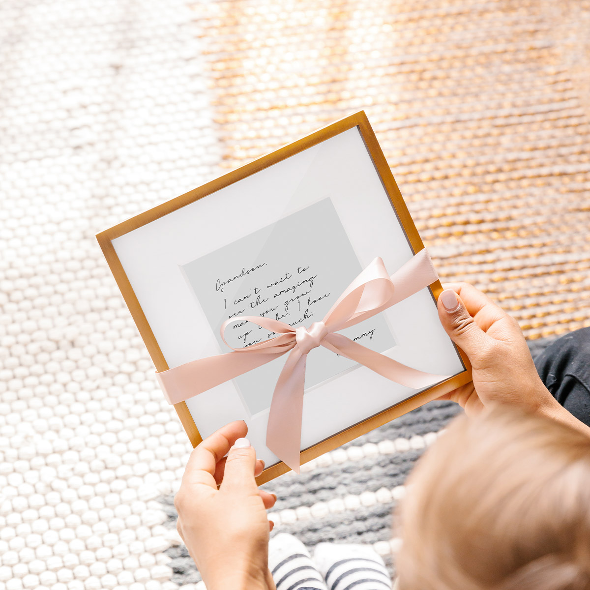 Framed note wrapped in pink bow