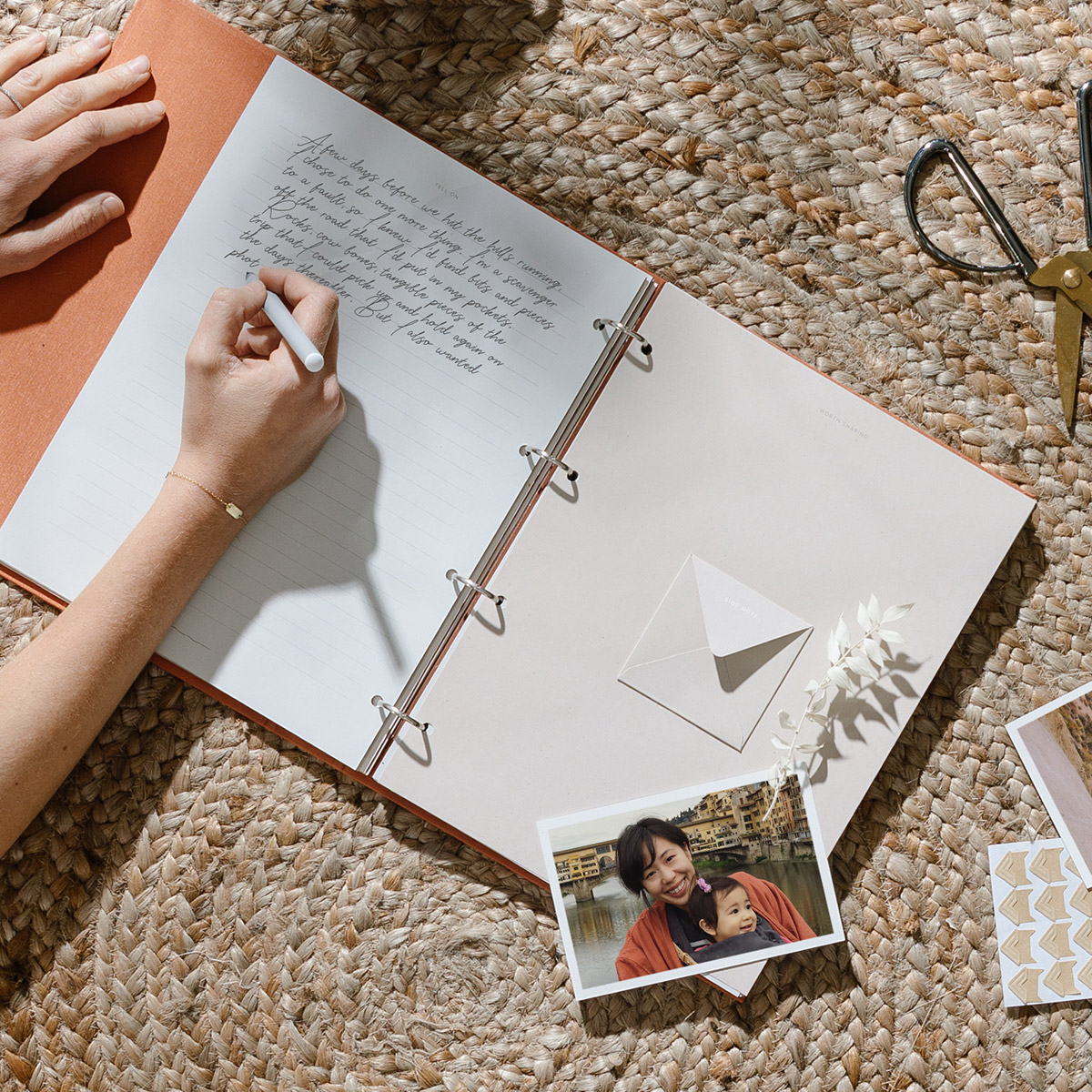 Hand writing letter in scrapbook