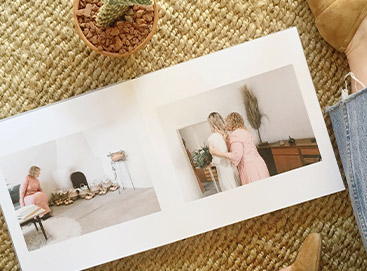 Wedding album opened to mother with daughter photos