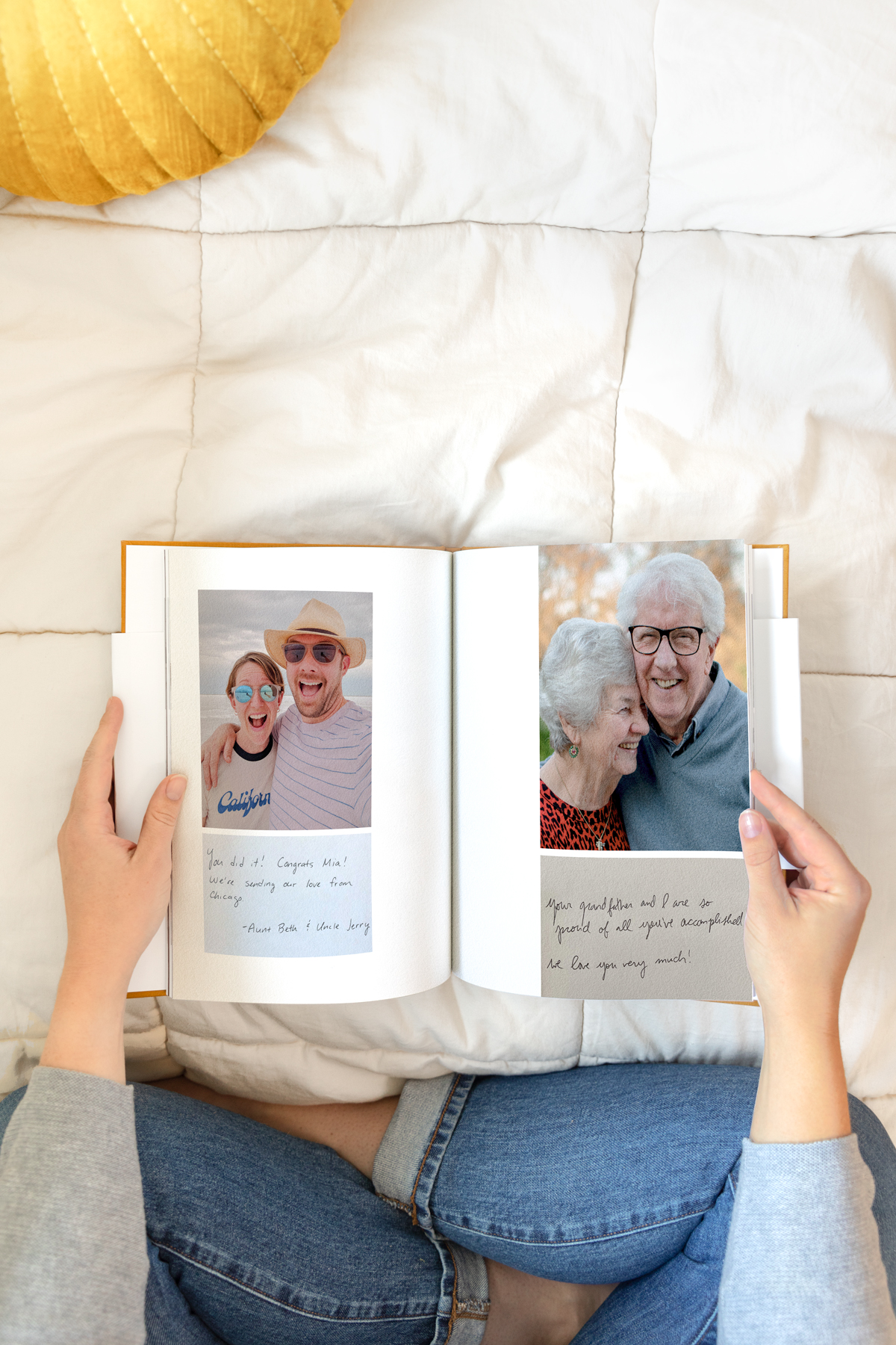 Artifact Uprising Hardcover Milestone Photo Book opened to photos and handwritten notes from family members