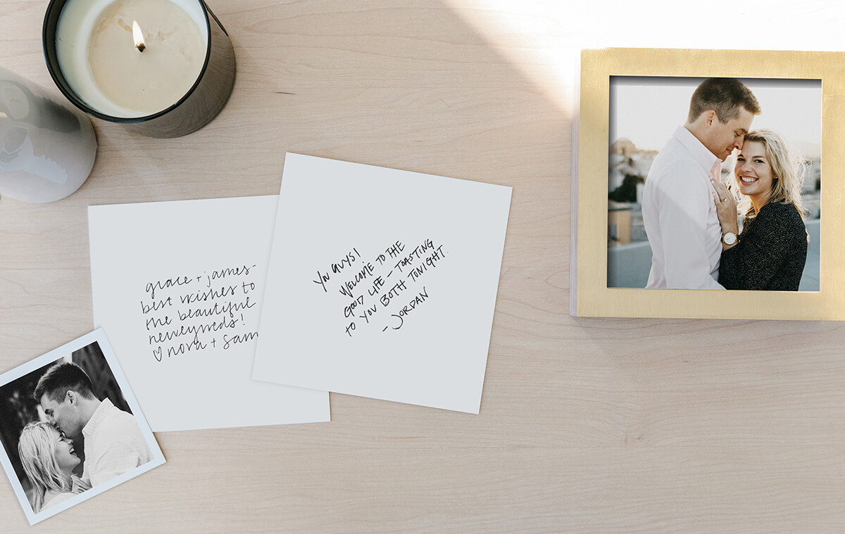 notes from wedding guests on the back of photo prints