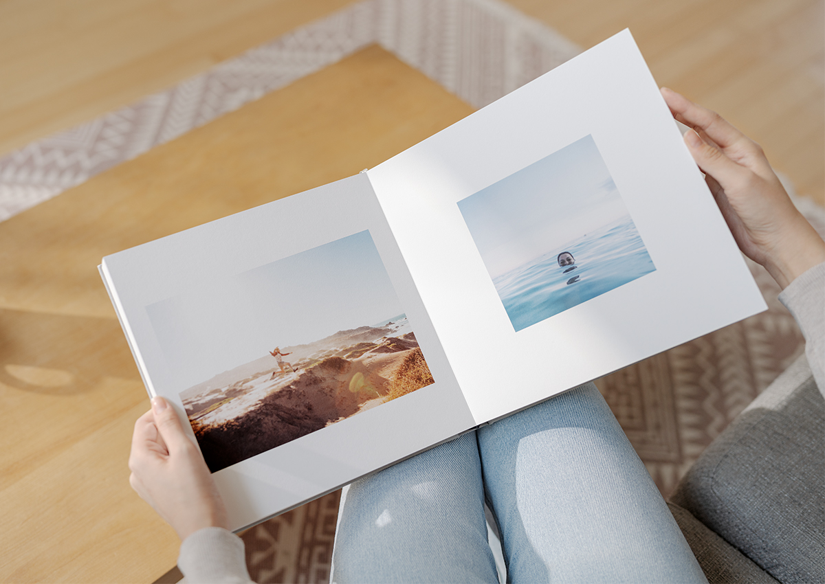 Photo book opened to side by side photos