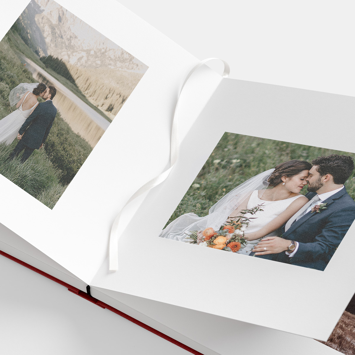 Bookmark ribbon marking page in opened photo album