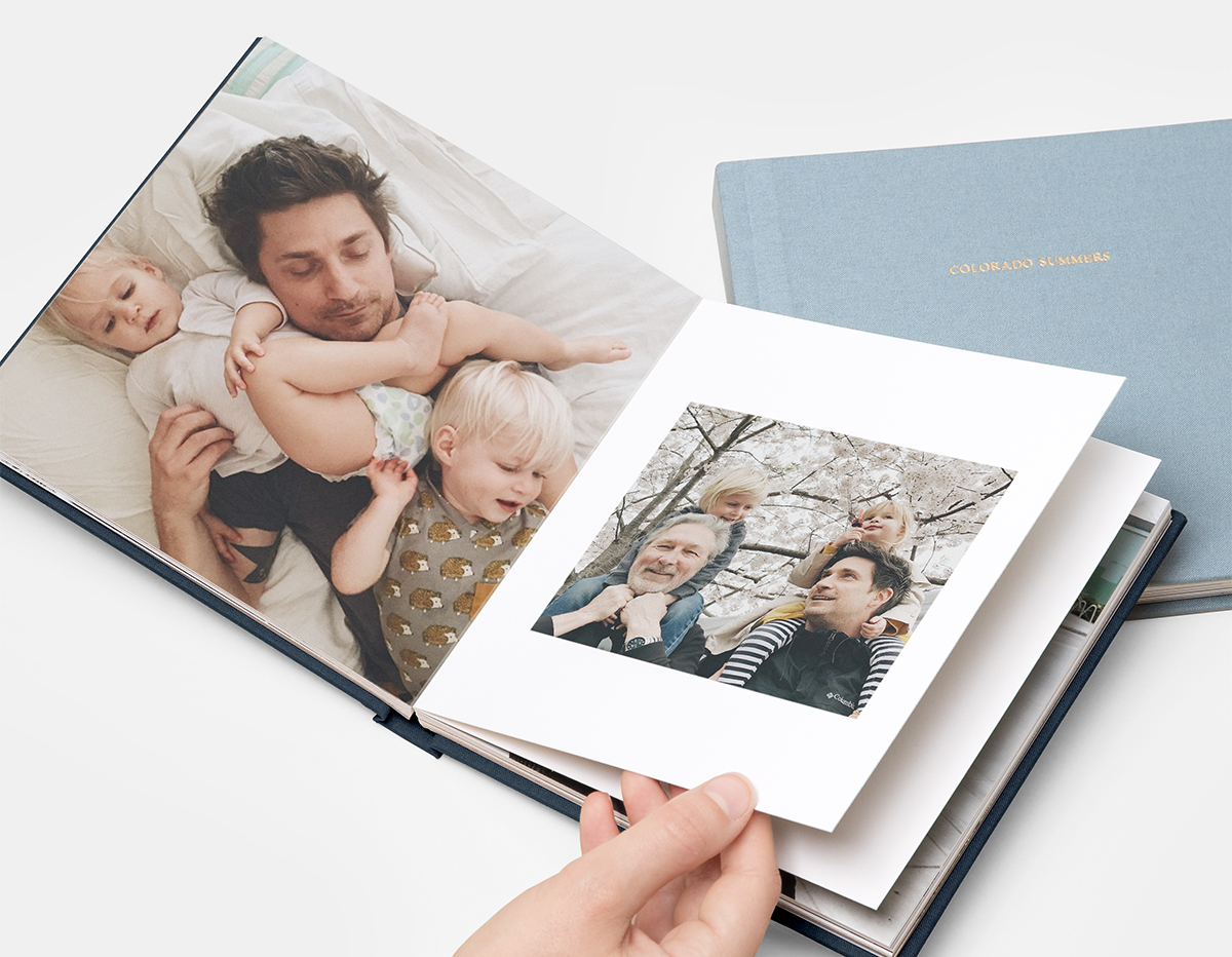 Photo album with pictures of father and children