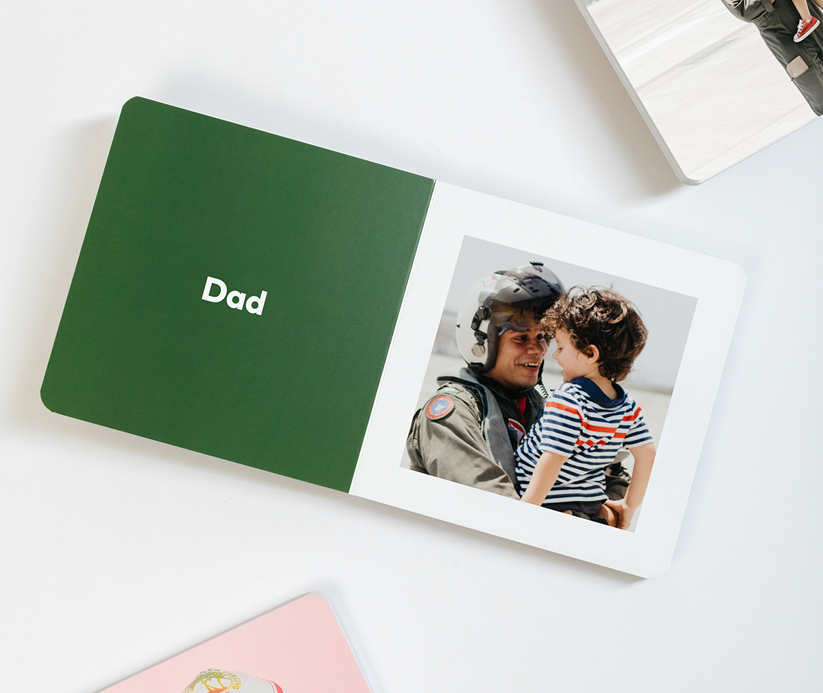 Baby Board Book opened up to photo of dad