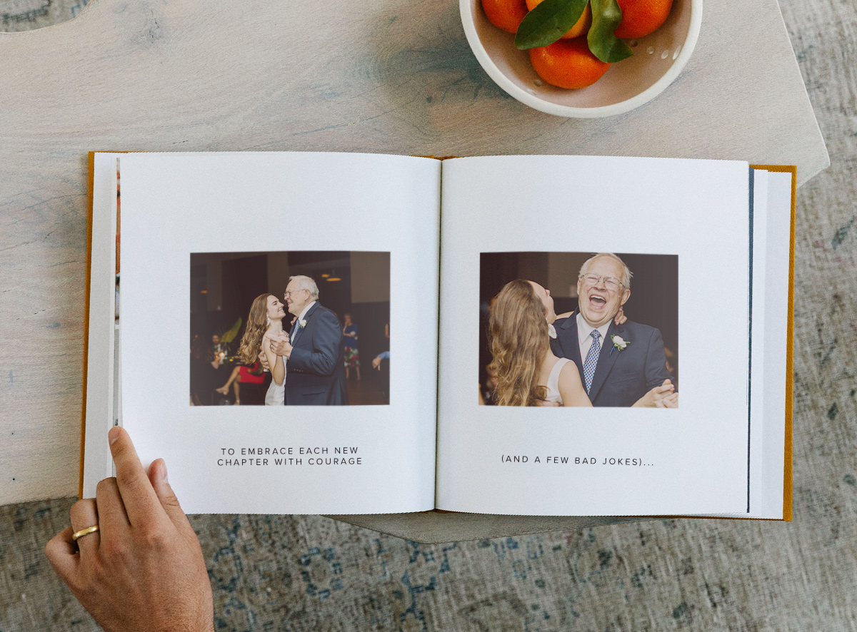 Photo book opened to photos of father and child with captions underneath images