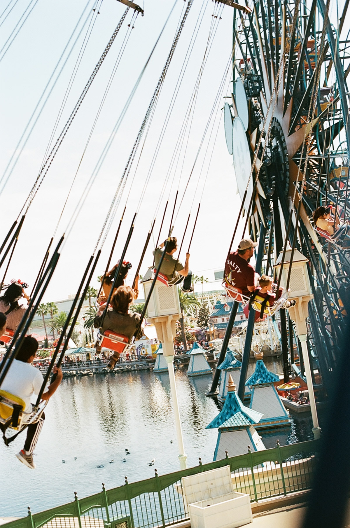 People riding carousel swing ride at an amusement park